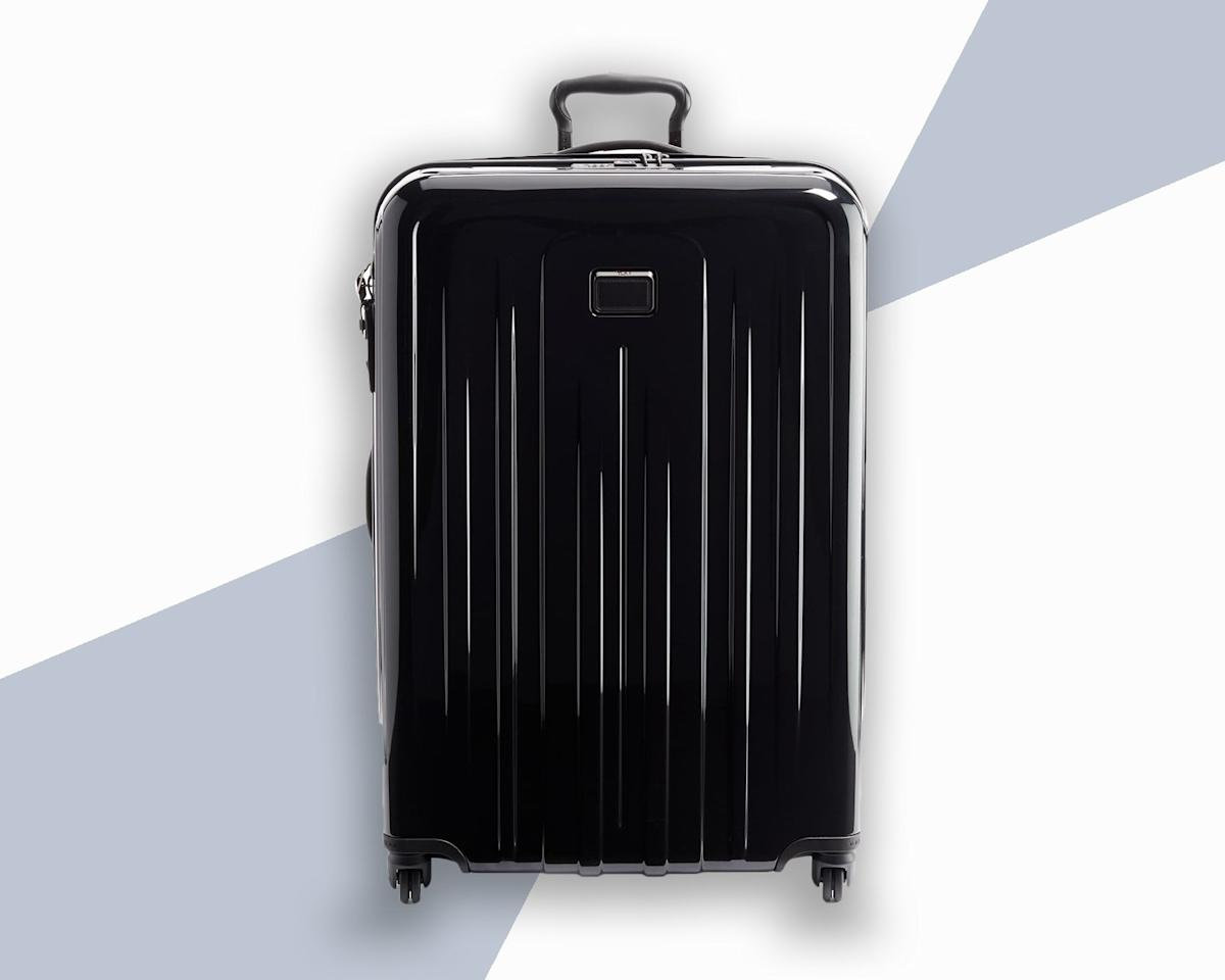"<p>It should come as no surprise that Tumi makes some of the best hard-sided luggage on the market. The lightweight Extended Trip Packing Case has an impact-resistant polycarbonate shell with an expandable fabric panel, should you need a bit more space than the 31-inch suitcase allots for. Other features include a two-way zipper, a TSA-approved lock, and on the inside, a hanger bracket plus multiple compartments. Worried about dents or scratches? Embrace it: This is the kind of bag that looks better and better with age.</p> <p><strong>Buy Now:</strong> $600, <a href=""https://click.linksynergy.com/deeplink?id=mcB7N8bf3MY&mid=1237&u1=hardshellluggage&murl=https%3A%2F%2Fshop.nordstrom.com%2Fs%2Ftumi-v4-collection-31-inch-extended-trip-expandable-spinner-packing-case%2F5288749"" rel=""nofollow"">nordstrom.com</a></p>"