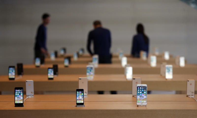 Various models of iPhone are displayed during a preview event at an Apple Michigan Avenue store, Thursday, Oct. 19, 2017, in downtown Chicago. (AP Photo/Kiichiro Sato)
