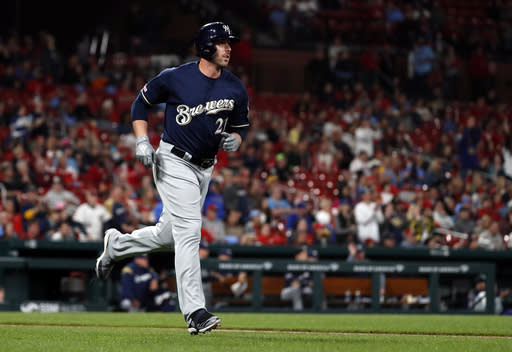 Milwaukee Brewers' Travis Shaw watches his solo home run during the sixth inning of a baseball game against the St. Louis Cardinals Tuesday, April 23, 2019, in St. Louis. (AP Photo/Jeff Roberson)