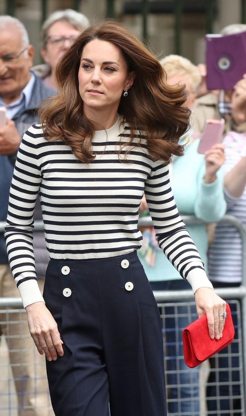 <p>The Duchess of Cambridge chose a nautical look for this morning's launch of the King's Cup. She paired a striped shirt with sailor-inspired trousers and a bright red handbag. </p>