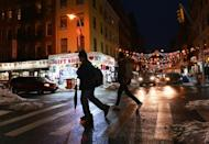 People walk through Chinatown in New York City on February 11, 2021