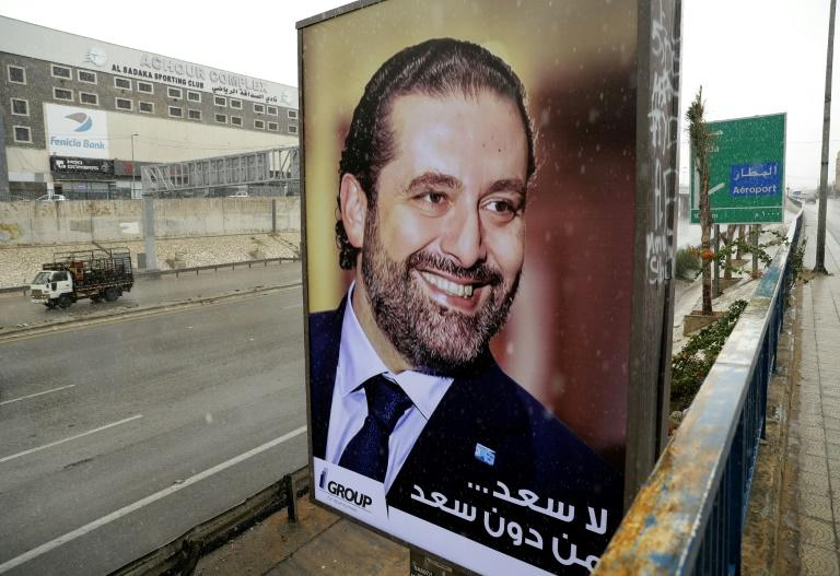 """There is no hapiness without Saad,"" reads a poster on the highway to Beirut airport bearing a portrait of Lebanese Prime Minister Saad Hariri, who is expected to return to his homeland on Wednesday"