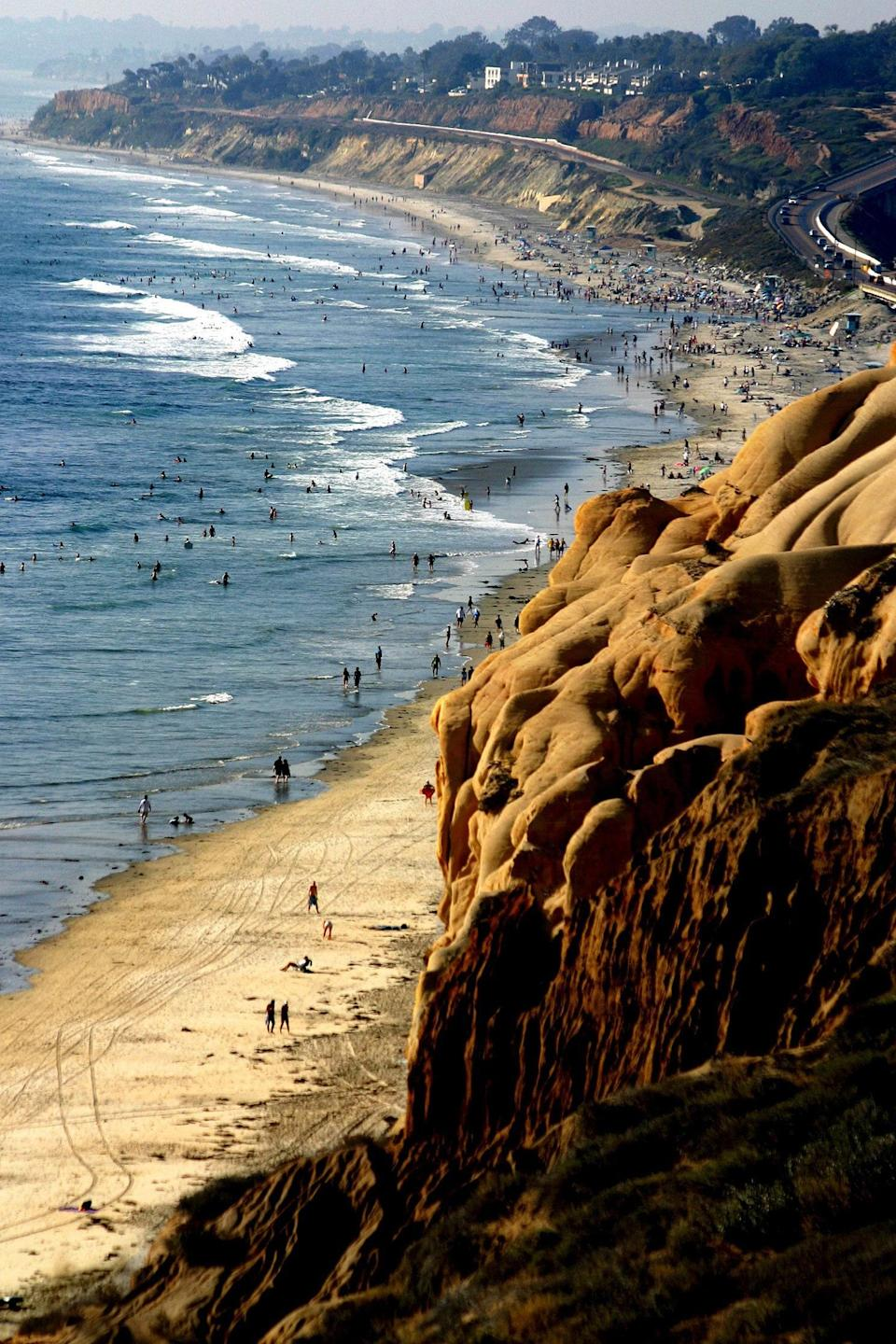 <p><strong>Let's start big picture here.</strong><br> La Jolla Shores is a crescent strip of sand with gentle waves, and the sea caves and underwater canyon make it popular as an easy launch spot for SCUBA diving and kayaking. By night, the sand comes alight with bonfires (there are six fire pits, available first-come, first-served.)</p> <p><strong>Tell us more about the sea caves.</strong><br> The La Jolla Underwater Park and Ecological Reserve draws kayakers who come to explore sea caves on kayak tours, and SCUBA divers should make their way toward the two underwater canyons. Harmless leopard sharks are known to congregate in La Jolla Shores during summertime, and can be easily spotted by divers or snorkelers.</p> <p><strong>What's the best way to experience the beach?</strong><br> Rent kayaks or take a guided tour from nearby La Jolla Kayak, La Jolla Sea Cave Kayaks, or Bike & Kayak Tours La Jolla. Those hoping to get in on the underwater action should take a guided SCUBA dive tour with La Jolla Dive or SD Expeditions. Beachgoers hoping to lounge or swim can simply grab a spot on the sand and enjoy the view.</p> <p><strong>All said and done, what—and who—is this best for?</strong><br> The beach is most appreciated on two ends of the spectrum: by travelers looking for an active day in the water, and by parents of smaller children who will enjoy the parks, playground, and gentle waves.</p>