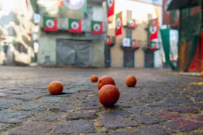 Oranges lie on the ground as the traditional