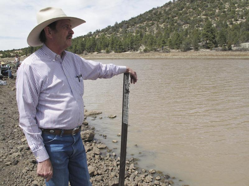 In this April 11, 2014 photo, John Moore, the mayor in Williams, Ariz., looks out onto a reservoir that the city relies on for water. City officials have declared a water crisis amid a drought that is quickly drying up nearby reservoirs and forcing the community to pump its only two wells to capacity. (AP Photo)