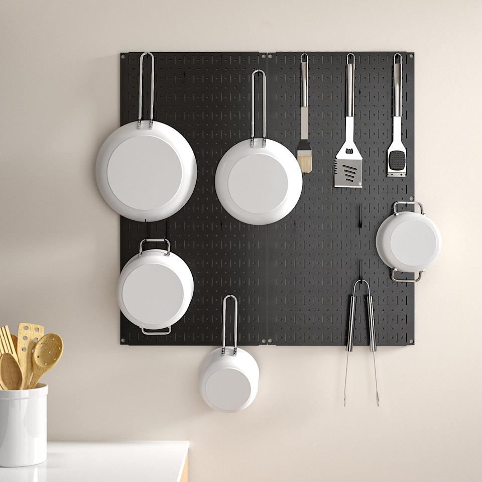 "<p>The <a href=""https://www.popsugar.com/buy/Kitchen-Organizer-Pots-amp-Pans-Pegboard-Pack-579047?p_name=Kitchen%20Organizer%20Pots%20%26amp%3B%20Pans%20Pegboard%20Pack&retailer=wayfair.com&pid=579047&price=64&evar1=casa%3Aus&evar9=47575922&evar98=https%3A%2F%2Fwww.popsugar.com%2Fhome%2Fphoto-gallery%2F47575922%2Fimage%2F47575947%2FKitchen-Organizer-Pots-Pans-Pegboard-Pack&list1=gadgets%2Ckitchens%2Chome%20shopping&prop13=mobile&pdata=1"" class=""link rapid-noclick-resp"" rel=""nofollow noopener"" target=""_blank"" data-ylk=""slk:Kitchen Organizer Pots &amp; Pans Pegboard Pack"">Kitchen Organizer Pots &amp; Pans Pegboard Pack</a> ($64) is a great space-saving option.</p>"
