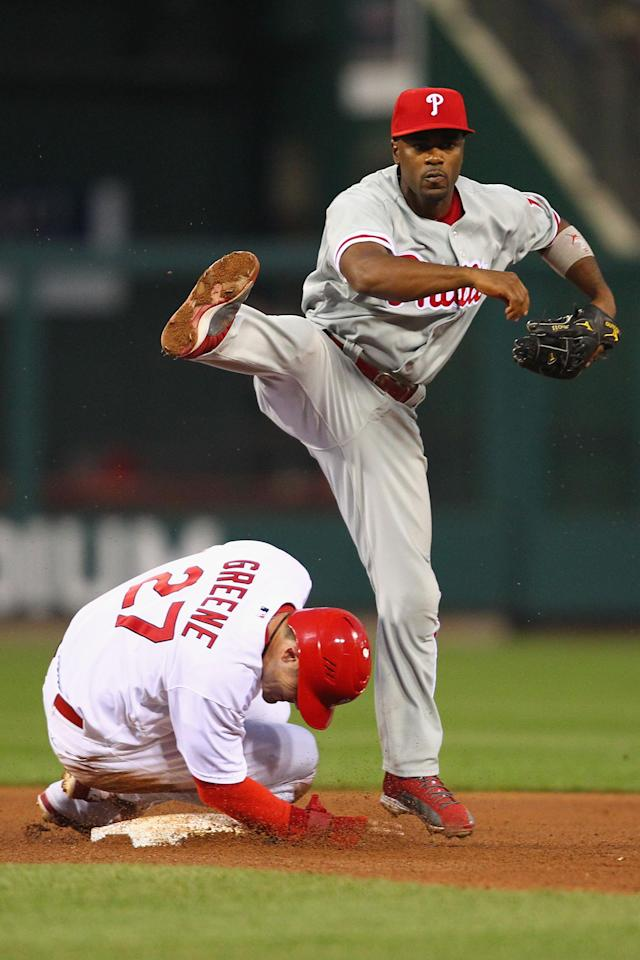 ST. LOUIS, MO - MAY 25: Jimmy Rollins #11 of the Philadelphia Phillies turns a double play over Tyler Greene #27 of the St. Louis Cardinals at Busch Stadium on May 25, 2012 in St. Louis, Missouri. (Photo by Dilip Vishwanat/Getty Images)