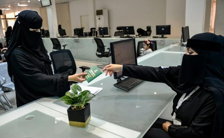 Saudi Arabia now allows women over the age of 21 to obtain passports without seeking the approval of their 'guardians' (AFP Photo/FAYEZ NURELDINE)