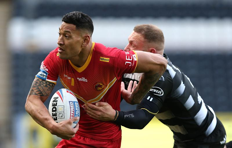 Israel Folau runs past past Josh Griffin during the Betfred Super League match.