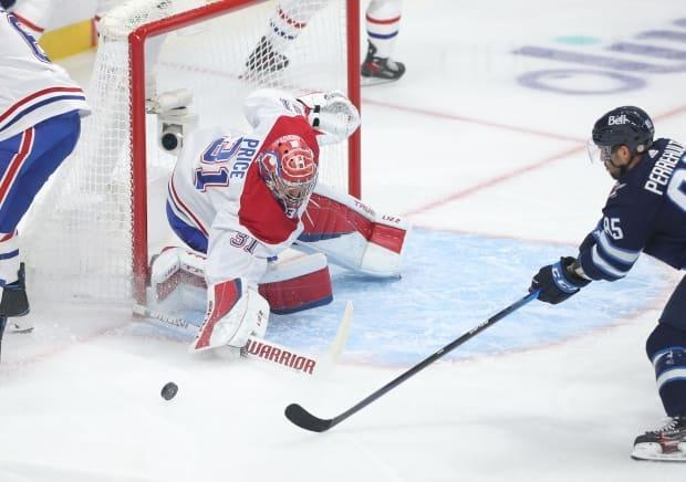 Montreal Canadiens goalie Carey Price makes a save during a 1-0 win over the Winnipeg Jets in Game 2 of their playoff series on Friday. (Jason Halstead/Getty Images - image credit)