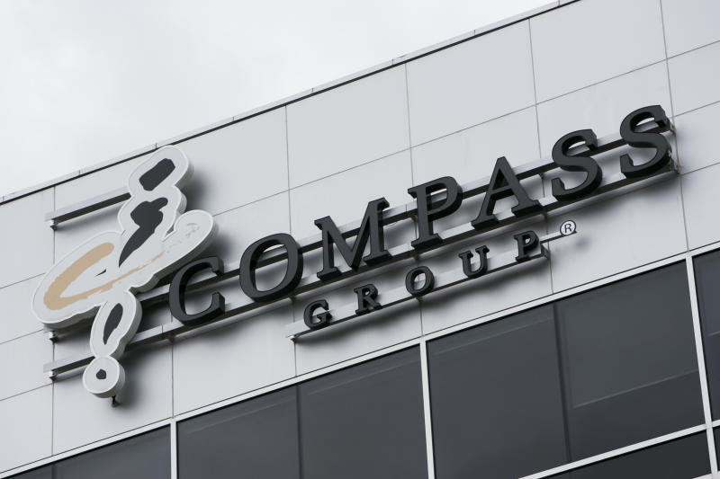 A logo sign outside of a facility occupied by the Compass Group in Mississauga, Ontario, Canada, on April 16, 2017. Photo by Kristoffer Tripplaar *** Please Use Credit from Credit Field ***