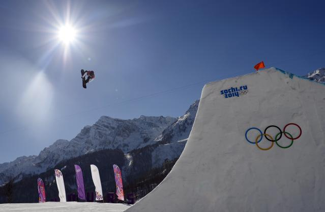 Canada's Sebastien Toutant performs a jump during the men's snowboard slopestyle final at the 2014 Sochi Olympic Games in Rosa Khutor