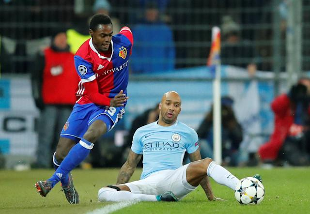 Soccer Football - Champions League - Basel vs Manchester City - St. Jakob-Park, Basel, Switzerland - February 13, 2018 Basel's Dimitri Oberlin in action with Manchester City's Fabian Delph REUTERS/Denis Balibouse