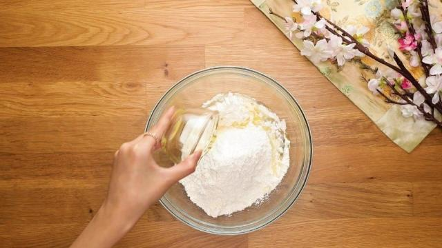 Adding oil to flour in a glass bowl