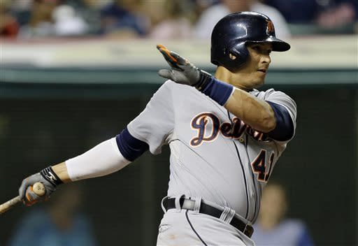 Detroit Tigers' Victor Martinez singles off Cleveland Indians relief pitcher Joe Martinez to drive in a run in the seventh inning of a baseball game on Friday, July 5, 2013, in Cleveland. (AP Photo/Mark Duncan)
