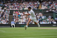Serbia's Novak Djokovic plays a return to Canada's Denis Shapovalov during the men's singles semifinals match on day eleven of the Wimbledon Tennis Championships in London, Friday, July 9, 2021. (AP Photo/Alberto Pezzali)