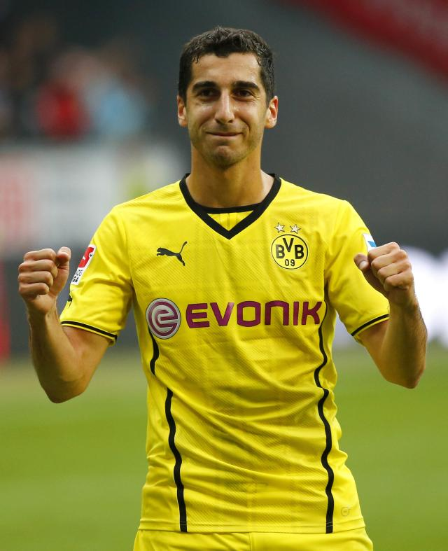 Henrikh Mkhitaryan of Borussia Dortmund celebrates his team's victory over Eintracht Frankfurt after their German first division Bundesliga soccer match in Frankfurt, September 1, 2013. Dortmund won the match 2-1 and Mkhitaryan scored twice. REUTERS/Kai Pfaffenbach (GERMANY - Tags: SPORT SOCCER) DFL RULES TO LIMIT THE ONLINE USAGE DURING MATCH TIME TO 15 PICTURES PER GAME. IMAGE SEQUENCES TO SIMULATE VIDEO IS NOT ALLOWED AT ANY TIME. FOR FURTHER QUERIES PLEASE CONTACT DFL DIRECTLY AT + 49 69 650050