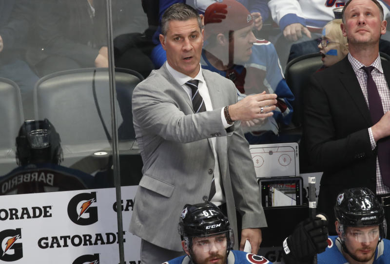 Colorado Avalanche coach Jared Bednar directs players against the New York Rangers during the first period of an NHL hockey game Wednesday, March 11, 2020, in Denver. (AP Photo/David Zalubowski)