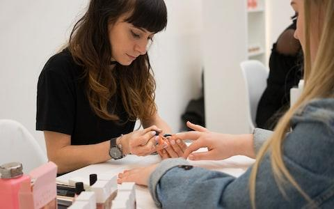A reader gets her free manicure at Stella Live 2019