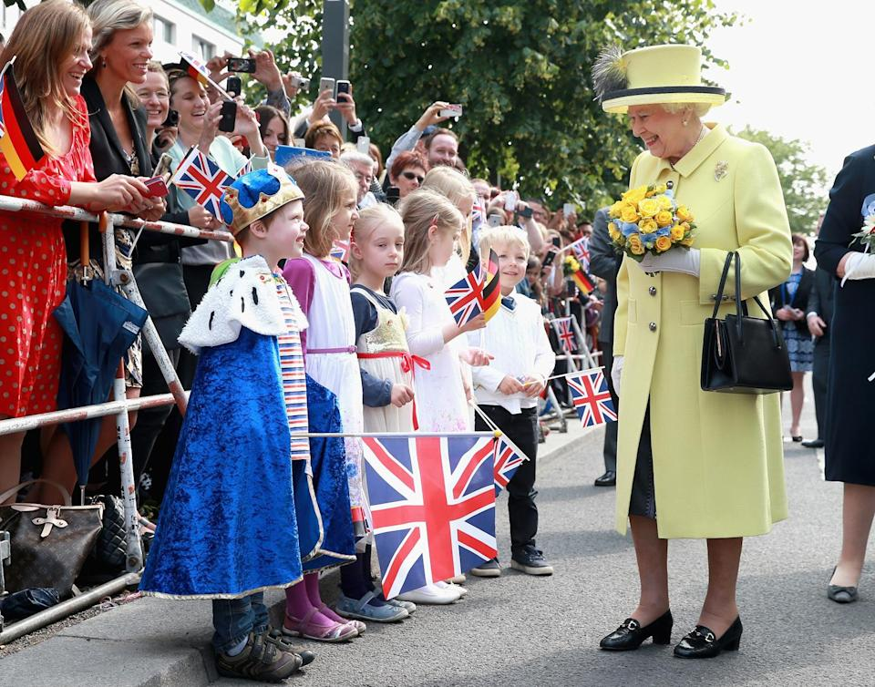 """<p>Queen Elizabeth's sweet rapport with children was also on display in an impromptu introduction to pint-sized German """"king"""" Konrad Thelen, 5, outside the Adlon Hotel in Berlin in June 2005.</p>"""