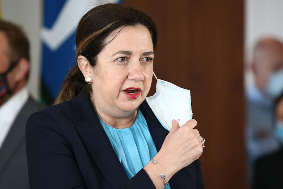 Queensland Premier Annastacia Palaszczuk takes off her face mask to speak during a press conference on June 29, 2021 in Brisbane, Australia