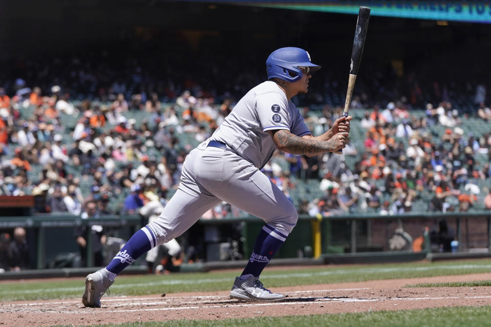 Los Angeles Dodgers' Julio Urias hits an RBI-single against the San Francisco Giants during the third inning of a baseball game in San Francisco, Sunday, May 23, 2021. (AP Photo/Jeff Chiu)