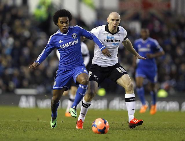 Chelsea's Willian, left, vies for the ball with Derby's Conor Sammon during the English FA Cup third round soccer match between Derby County and Chelsea at the iPro Stadium in Derby, England, Sunday, Jan. 5, 2014. (AP Photo/Kirsty Wigglesworth)