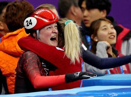 Feb 13, 2018; Pyeongchang, South Korea; Kim Boutin (CAN) celebrates winning bronze in the women's short track speed skating 500m finals during the Pyeongchang 2018 Olympic Winter Games at Gangneung Ice Arena. Mandatory Credit: Geoff Burke-USA TODAY Sports