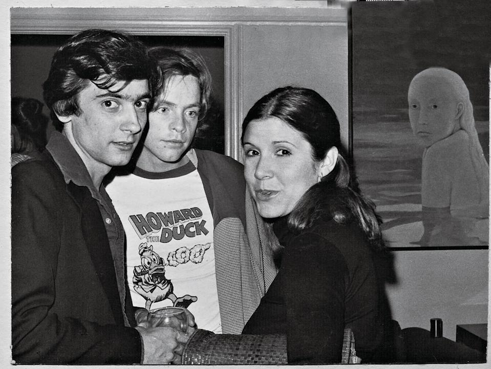 """<p>""""She said, 'I run around with a ray gun and a big ape,'"""" Dunne (left, with Mark Hamill and Carrie Fisher) continues. """"But that night at Camilla's, the trio were very aware they were on a wave of something huge.""""</p>"""
