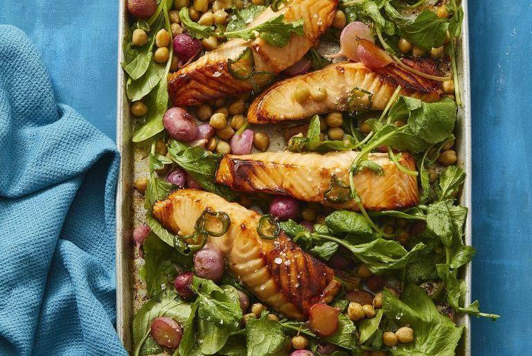 """<p>Add a little kick to your healthy dinner tonight with these jalapeño-infused honey and spicy radish greens that put a new twist on your typical roasted salmon. </p><p><em><a href=""""https://www.womansday.com/food-recipes/a32291919/hot-honey-roasted-salmon-and-radishes-recipe/"""" rel=""""nofollow noopener"""" target=""""_blank"""" data-ylk=""""slk:Get the Hot Honey-Roasted Salmon and Radishes recipe."""" class=""""link rapid-noclick-resp"""">Get the Hot Honey-Roasted Salmon and Radishes recipe.</a></em></p>"""