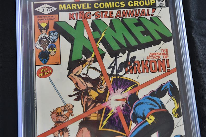 "A Stan Lee-signed copy of the 1979 ""X-Men Annual #3"" is displayed at Julien's Auctions in Beverly Hills, California, on November 13, 2018. - The comic book is part of a selection of 20 works associated with Lee's comics universe which will be sold November 16-17 at Julien's Auctions' Beverly Hills gallery and online. Stan Lee, who was the editor-in-chief of Marvel Comics, died November 12 in Los Angeles at age 95. (Photo by Robyn Beck / AFP) (Photo credit should read ROBYN BECK/AFP/Getty Images)"