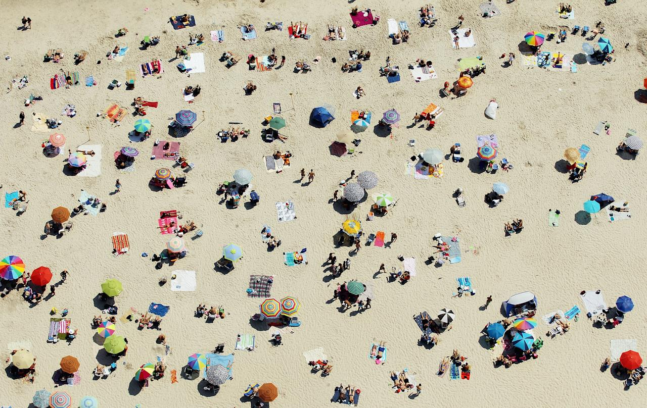 An aerial view of New Yorkers cooling off at Jones Beach on August 4, 2012 in Wantagh, New York. The past year through June 2012 in the continental Unite States has been the hottest since modern record-keeping started in 1895, according to the National Oceanic and Atmospheric Administration (NOAA). NOAA also reports the ten warmest years since 1895 have occurred since 2000. A weather expert at the agency suggested climate change has a role in the high temperatures. (Photo by Mario Tama/Getty Images)