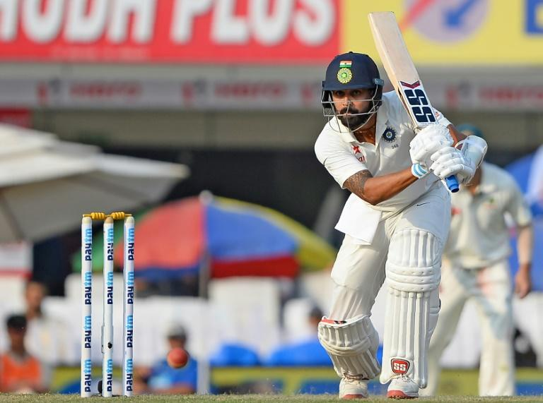 Indian batsman Murali Vijay plays a shot during the second day of the third Test match against Australia in Ranchi on March 17, 2017
