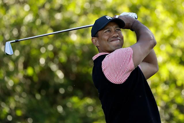 Tiger Woods hits his tee shot on the 11th hole of the South Course at Torrey Pines Golf Course during the final round of the Farmers Insurance golf tournament Sunday, Jan. 27, 2019, in San Diego. (AP Photo/Gregory Bull)