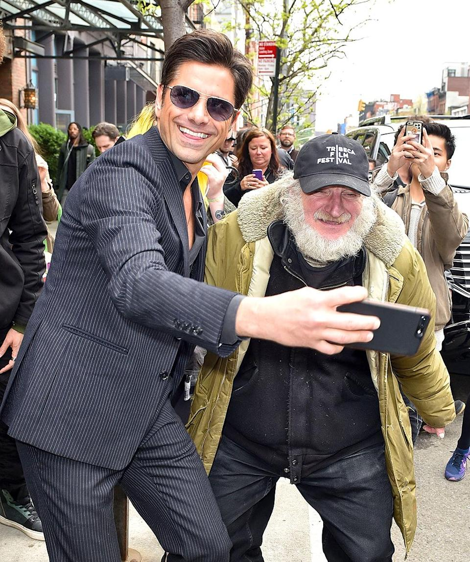 <p>Have mercy! The <i>Full House</i> hunk was looking good as he snapped a photo with Radioman, a longtime fixture on the streets of New York. (Photo: AKM-GSI) </p>