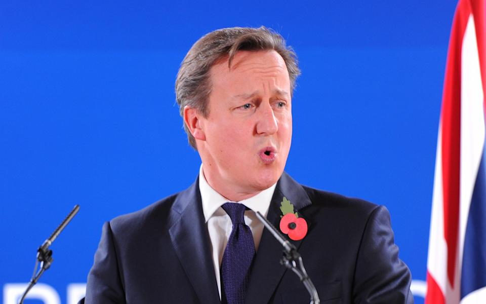 BRUSSELS, BELGIUM - OCTOBER 24 :  British Prime Minister David Cameron speaks during a press conference at the end of a two-day European Council meeting in Brussels, Belgium on October 24, 2014. (Photo by Dursun Aydemir/Anadolu Agency/Getty Images)