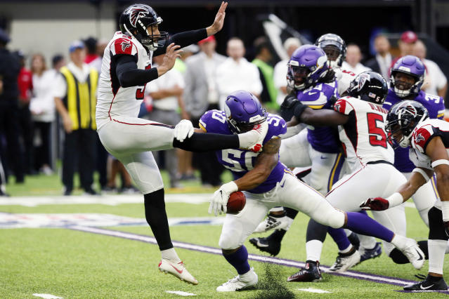 Minnesota Vikings linebacker Eric Wilson (50) blocks a punt by Atlanta Falcons punter Matt Bosher, left, during the first half of an NFL football game, Sunday, Sept. 8, 2019, in Minneapolis. (AP Photo/Jim Mone)