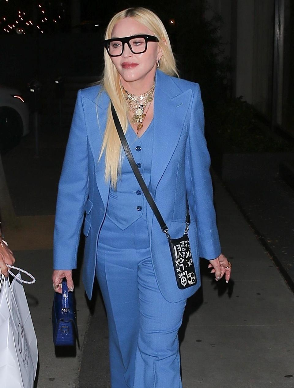 <p>Madonna sports a blue three-piece suit while out after dinner at Craig's in West Hollywood on Tuesday.</p>