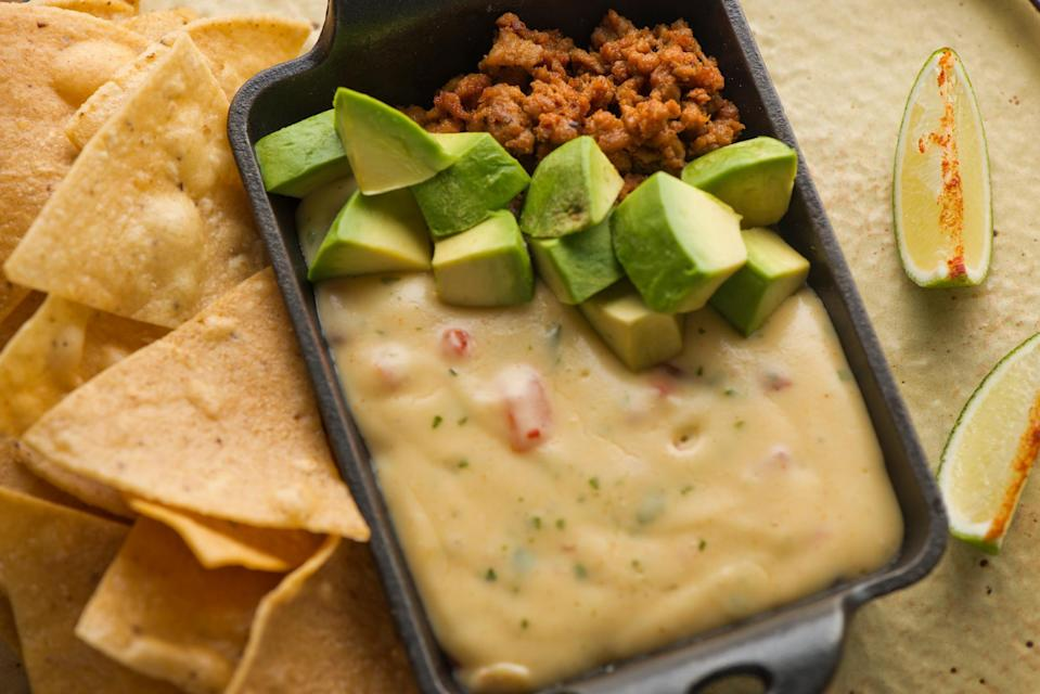 """<p>Want a quick and easy cheesy fix? This queso calls simply for Velveeta cheese and a can of Rotel tomatoes. </p> <p><a href=""""https://www.thedailymeal.com/recipes/green-chile-con-queso-recipe?referrer=yahoo&category=beauty_food&include_utm=1&utm_medium=referral&utm_source=yahoo&utm_campaign=feed"""" rel=""""nofollow noopener"""" target=""""_blank"""" data-ylk=""""slk:For the Chile Con Queso recipe, click here."""" class=""""link rapid-noclick-resp"""">For the Chile Con Queso recipe, click here.</a></p>"""