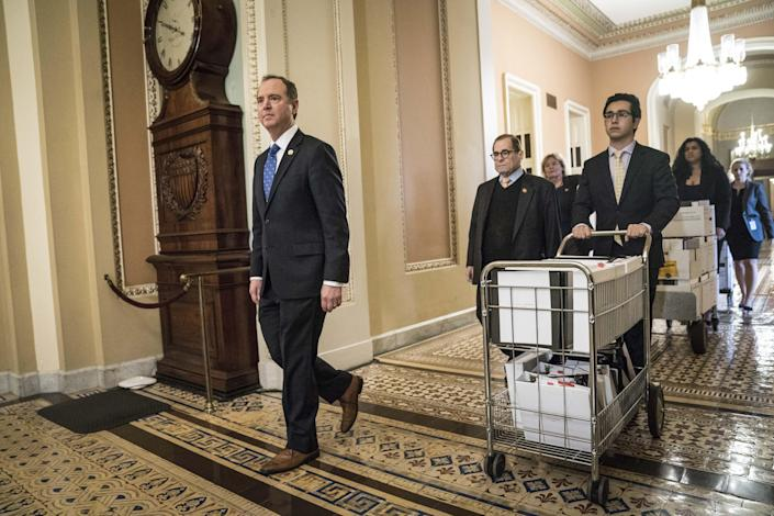 House impeachment managers Adam Schiff, Jerry Nadler and Zoe Lofgren, rear, deliver new documents to the Senate floor on Jan. 25. (Photo: Sarah Silbiger/Bloomberg via Getty Images)