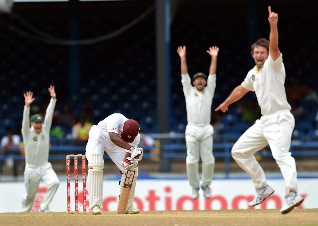West Indies Kieran Powell (C) is LBW as Australian bowler Ben Hilfenhaus (R) and teammates appeal during the final day of the second-of-three Test matches between Australia and West Indies April19, 2012 at Queen's Park Oval in Port of Spain, Trinidad.