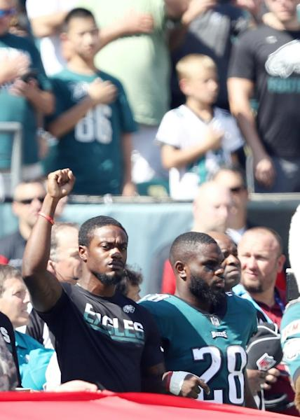 Philadelphia Eagles players lock arms during the national anthem before the game against the New York Giants