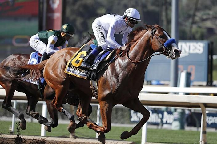 """Jockey Mike Smith urges Justify past Bolt d'Oro, ridden by Javier Castellano, during the Santa Anita Derby in 2018. <span class=""""copyright"""">(Associated Press)</span>"""