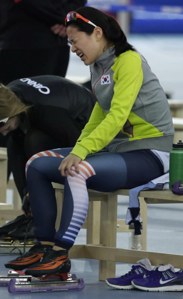 South Korea's Lee Bo-ra holds her leg and grimaces in pain after crashing during the women's 1,000-meter speedskating race at the Adler Arena Skating Center during the 2014 Winter Olympics in Sochi, Russia, Thursday, Feb. 13, 2014.(AP Photo/Matt Dunham)