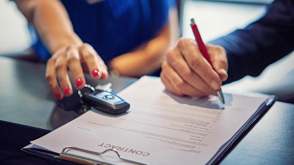 signing to buy used car with cash.