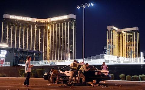 Las Vegas police stand guard along the streets outside the festival grounds of the Route 91 Harvest - Credit: David Becker/Getty