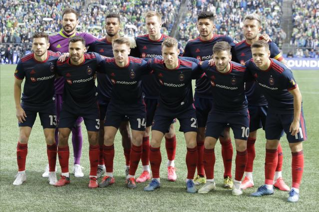 Chicago Fire players pose for the traditional pre-match portrait before an MLS soccer match against the Seattle Sounders, Sunday, March 1, 2020, in Seattle. (AP Photo/Ted S. Warren)