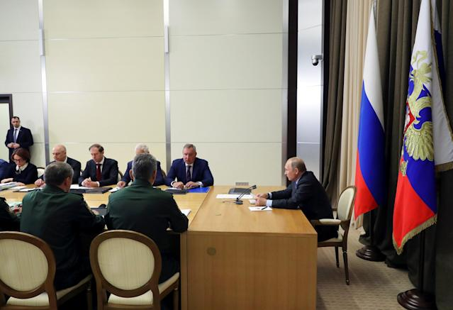 Russian President Vladimir Putin (R) chairs a meeting with high military command and officials in the Black Sea city of Sochi, Russia May 16, 2018. Sputnik/Mikhael Klimentyev/Kremlin via REUTERS ATTENTION EDITORS - THIS IMAGE WAS PROVIDED BY A THIRD PARTY.