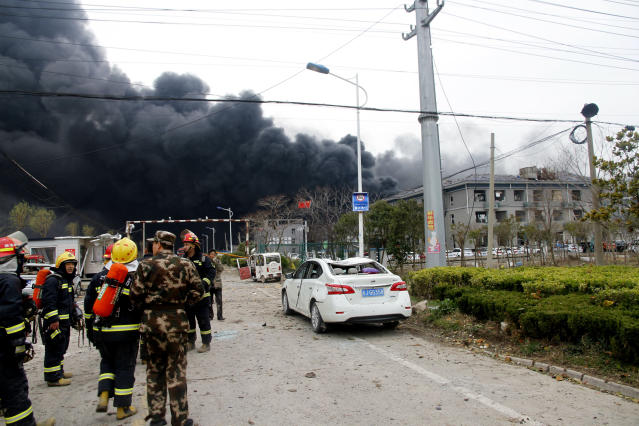 In this Thursday, March 21, 2019, photo, rescuers walk near the site of a factory explosion in a chemical industrial park in Xiangshui County of Yancheng in eastern China's Jiangsu province. The local government reports the death toll in an explosion at a chemical plant in eastern China has risen with dozens killed and more seriously injured. (Chinatopix via AP)