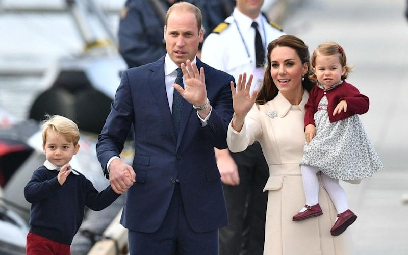 The Duke and Duchess of Cambridge with their children on their tour of Canada last year - Credit: Dominic Lipinski/PA